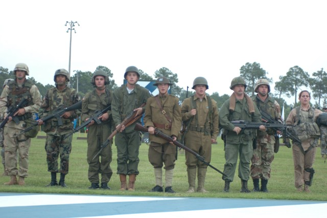 """Third Infantry Division Soldiers sing the Dog Face Soldier song in historic dress during Twilight Tattoo """"Salute to the Nation"""" on Cottrell field, July 2."""