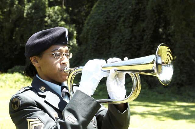 Staff Sgt. Kimberly Tapia plays taps as part of her Honor Guard duties.