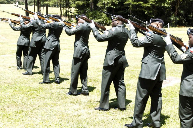 The Honor Guard fires the first of three vollies during the 21-gun salute.