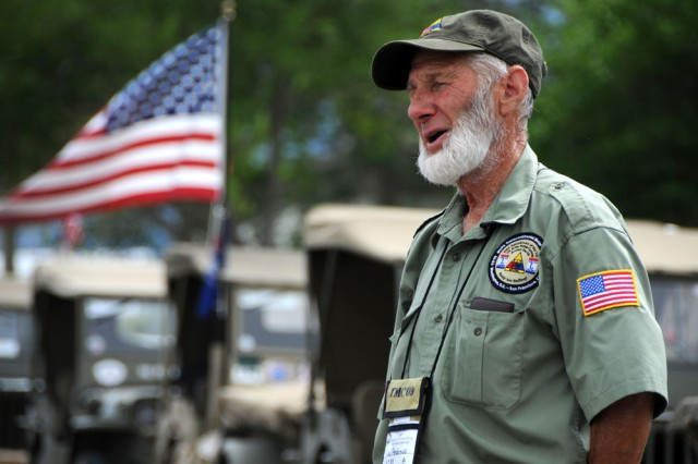 Clyde Andrews, a member of the Military Vehicle Preservation Association 2009 Transcontinental Motor Convoy, explains the purpose of the trek for an interview July 2, 2009. The MVPA 2009 TMC, which is traveling from Washington, D.C. to San Francisco, California to retrace the original 1919 route along the Lincoln Highway, stoped on Dugway Proving Ground, Utah, during its trek.
