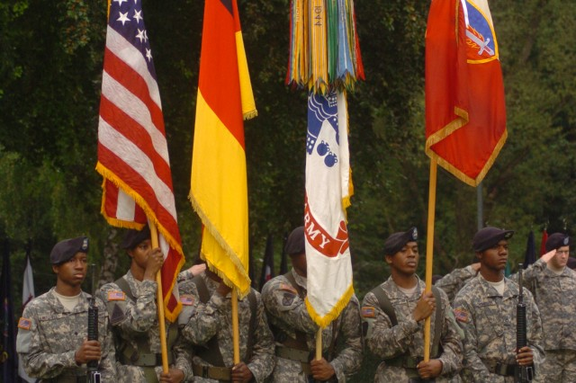 Soldiers from the 21st Theater Sustainment Command's Color Guard present arms during a change of commander ceremony for the 409th Contracting Support Brigade held at Panzer Parade Field July 9. Col. Debra Daniels assumed command from Col. Stephen Leisenring.