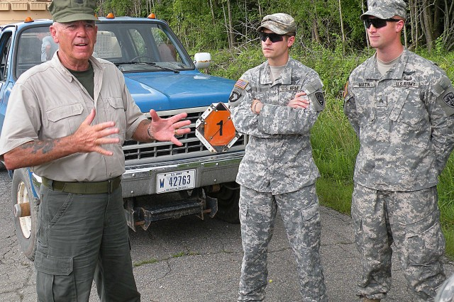 """Retired Marine Corps Gunnery Sgt. R. Lee Ermey talks to Soldiers assigned to the Aberdeen Test Center during his visit to Aberdeen Proving Ground in June, to film segments of an upcoming TV series called """"Lock-n-Load."""""""