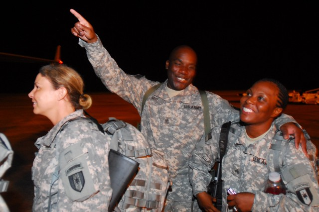 1SG Theon Hart points to the stairs as the final Soldier, SGT Felicia Winfrey, boards the aircraft bound for Kuwait. The 14th Combat Support Hospital began a yearlong tour to Iraq this week as two flights carrying approximately 380 Soldiers departed from Lawson Army Airfield.