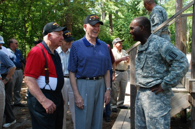 Capt. Rodney Jackson, Company A, 3rd Battalion, 60th Infantry Regiment commander, answers questions from World War II veterans during an honor flight tour stop at the confidence course on Fort Jackson, S.C., July 2.