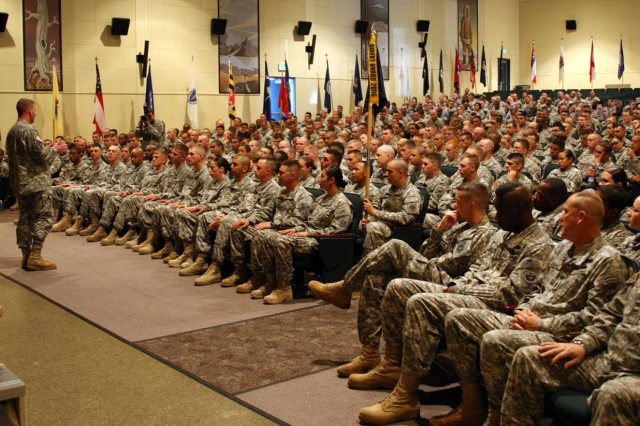 Sgt. Maj. of the Army Kenneth O. Preston responds to Soldiers' questions during a town-hall forum July 7, at Fort Richardson, Alaska.