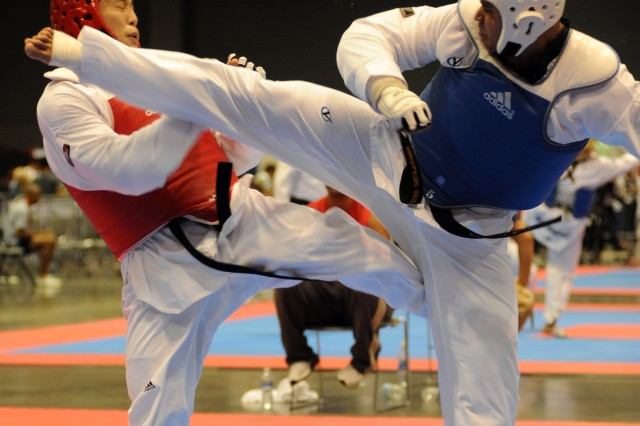2nd Lt. Steven Ostrander kicks New Jersey's Jonathan Lee in the face during his 12-1 semifinal victory en route to his third career crown in the heavyweight division of the U.S. National Taekwondo Championships July 5 at the Austin Convention Center in Texas.