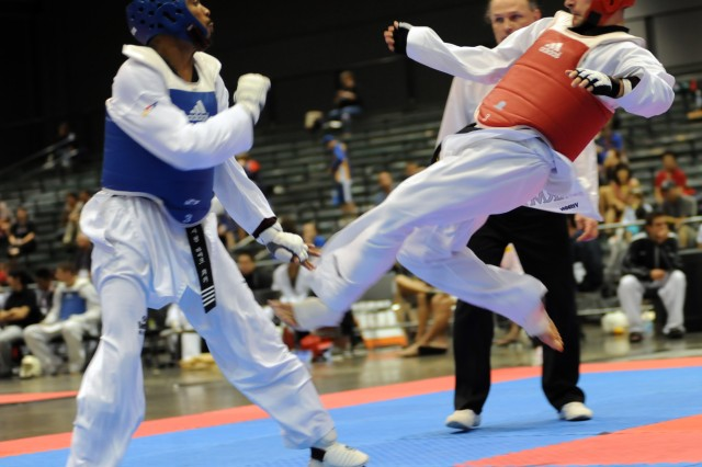 U.S. Army World Class Athlete Program martial artist Sgt. William Rider kicks Michigan's Michael Walker en route to a 4-2 victory July 5 at the 2009 U.S. National Taekwondo Championships at Austin Convention Center in Texas. Rider won a silver medal in the featherweight division.