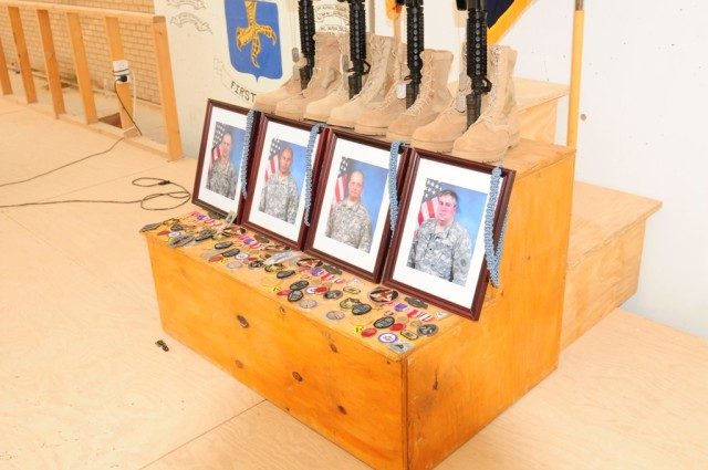 MAHMUDIYAH, Iraq - The traditional memorial of boots, rifle, helmet, and dog-tags stands in honor of Sgt. First Class Edward Kramer, Sgt. Juan Baldeosingh, Sgt. Roger Adams Jr. and Spc. Robert Bittiker, during a memorial service held in their honor a...