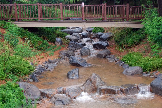 The new storm water retention basin at Humphreys Garrison, Korea, has a practical as well as an aesthetic use. It includes a small pond, two streams with native plants along their banks, benches and walkways made of recycled materials.