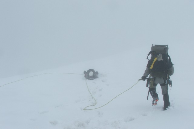 Soldiers from 1st Special Forces Group (Airborne) practice rope team arrest and rescue in conditions of limited visibility during medical training on Mt. Rainier. Mount Rainier, located near Ashford, Wash., is the tallest mountain in the Cascade Mountain range. Arresting and rescue requires team members to work together to safely retrieve a member who may fall into a crevasse or lose footing in some other manner while conducting mountaineering operations.