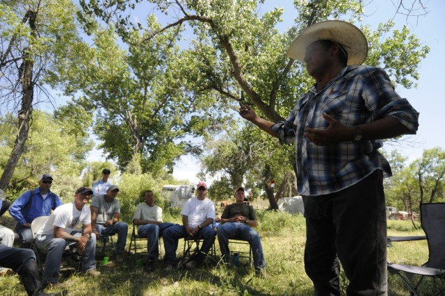 "Henry ""Hank"" realbird, a member of the Crow indian family, speaks to members of 1st Squadron, 73rd Cavalry Regiment, 2nd Brigade Combat Team, 82nd Airborne Division about the history of the Crow family at Little Big Horn, Montana. Squadron leaders jumped onto the battlefield June 28 for a four-day Staff Ride."