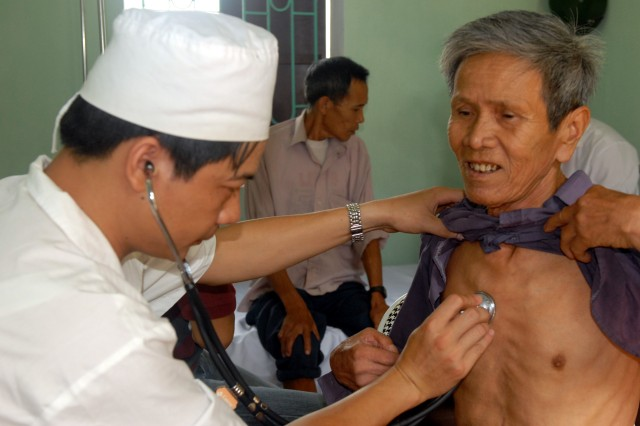 Vietnamese Army Dr. (Capt.) Le Khac Hiep examines an elderly man during the third day of a Medical Readiness Training Exercise in the Bac Ninh province of Vietnam, July 11. This is the first bilateral Medical Readiness Exercise, co-hosted by Vietnam and the United States, and is intended to improve medical interoperability between the Military Medical Department of Vietnamese People's Army (MMD) and U.S. Army Pacific, provide experience and education for medical operations in harsh environments, unfamiliar culture, and unusual diseases with austere support; and provide humanitarian assistance. The MEDRETE is scheduled to end July 15.
