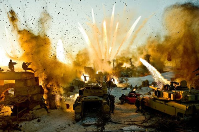 "Shown is a battle scene from ""Transformers: Revenge of the Fallen"" in which Soldiers from the 1st Armored Division operate the tracked vehicles."