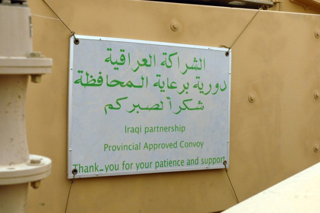 Signs like this were recently added to 2nd Brigade, 1st Cavalry Division, vehicles explaining to Iraqi residents that the local provincial government has approved these convoys to operate within the city. This comes after the June 30 deadline, as part of the Security Agreement, limiting U.S presence in the cities to advisory and assistance teams and other teams serving in non-combat roles.