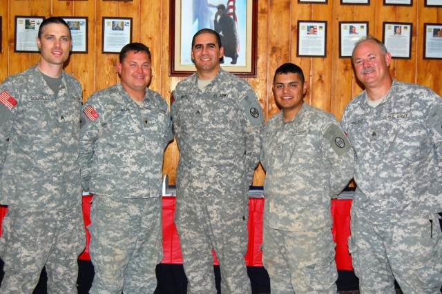 BAGHDAD - Soldiers of the 30th Heavy Brigade Combat Team's band 'Seeking Solace' are, from left: Sgt. Brian Douglas, Charlotte, N.C.; Spc. John Riggs, Kinston, N.C.; Sgt. Stephen Ortiz, Fort Meade, Md.; Pfc. Cesar Titus, Statesville, N.C.; and Sgt. David Shively, Eden, N.C.  The band formed to play at chapel services and recently played at Forward Operating Base Falcon's Independence Day celebration.