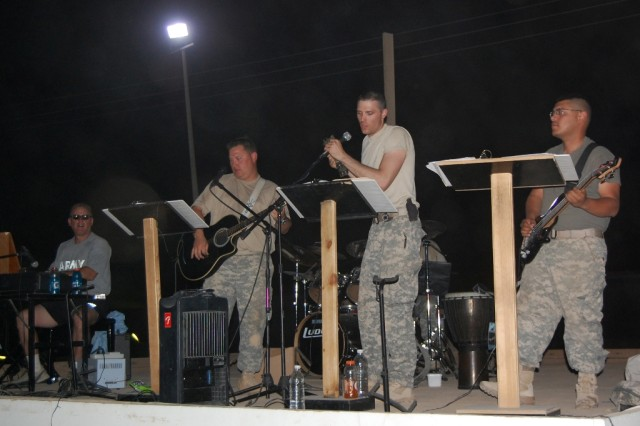 BAGHDAD - Seeking Solace, a band comprised of 30th Heavy Brigade Combat Team members, gave a special July Fourth concert to entertain a crowd of about 100 Soldiers and civilians on Forward Operating Base Falcon. They usually play at Sunday worship services. The band name represents extending peace and comfort through music to Soldiers seeking it here in Iraq.