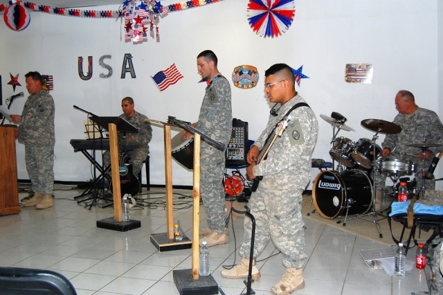 BAGHDAD - Seeking Solace, a band comprised of 30th Heavy Brigade Combat Team Soldiers performs for a crowd of about 50 people at a July Fourth prayer luncheon on Forward Operating Base Falcon. The band members, who were musicians for churches back home, volunteered to play at Sunday worship services at the Falcon Steel Chapel here.