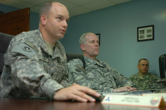 Lt. Col. Peter M. Haas, the 49th Transportation Battalion commander briefs Brig. Gen. Michael J. Lally, commanding general of the 3d Sustainment Command Expeditionary about 49th Trans. Bn. operations during Lally's visit to the 49th Trans. Bn. headquarters at Joint Base Balad, Iraq July 2.