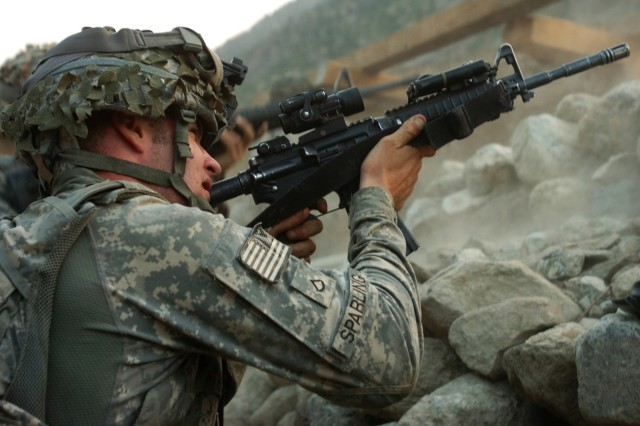 A U.S. Army Soldier with 1st Battalion, 32nd Infantry Regiment, 10th Mountain Division, fires at anti-Afghanistan forces in the hills surrounding the remote village of Barge Matal during Operation Mountain Fire in Afghanistan's Nuristan province, July 12. U.S. and Afghan national security forces quickly secured the tiny mountain village, which was overwhelmed by AAF several days prior. (Photo by U.S. Army Sgt. Matthew C. Moeller, 5th Mobile Public Affairs Detachment)