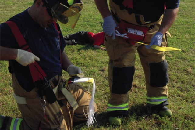 Boy Scout Timothy Bedford, 10, of Tidewater Council Boy Scout Troop 996 is evaluated for simulated injuries by Fort Story Fire Department firefighters during a Naval Amphibious Base Little Creek - Fort Story joint base mass casualty exercise July 8 at Chapel Field on Story.