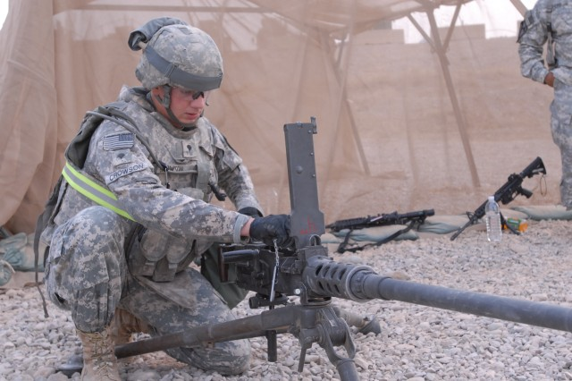 Spc. John Crowson, a Vanville, Va., native and an artilleryman with Battery B, 3rd Battalion, 82nd Field Artillery Regiment, 2nd Brigade Combat Team, 1st Cavalry Division, displays his knowledge of the 50 Caliber Machine Gun during a competition for Non-Commissioned Officer of the Quarter and Soldier of the Quarter July 10 on Forward Operating Base Warrior, Kirkuk, Iraq.