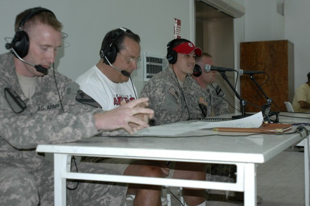 2nd Lt. Charlie Rockwood with Headquarters Troop, 1st Cavalry Division, Capt. Josh Holden with 2nd Battalion, 82nd Field Artillery Regiment, and Sgt. Patrick Miller, with 1st Battalion 12th Cavalry Regiment participate in a live radio broadcast with sports talk radio host Ron Barr (second from left). The syndicated national U.S. sports talk show, Sports Byline, was broadcast from the Forward Operating Base Marez dining facility on July 14.