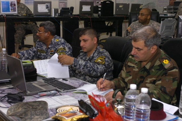 Iraqi Security Forces liaison officers work in the 3rd Battalion, 8th Cavalry Regiment Tactical Operations Center. These Iraqi officers transfer information back and forth between Iraqi and U.S. Forces.