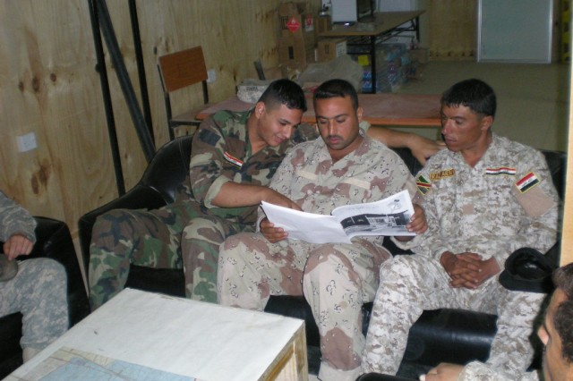 BAGHDAD - Some 6th Iraqi Army Engineer Regiment Soldiers receive training to help build five Army B-huts and safety platforms in five guard towers at Joint Security Station Tarmiyah.  These Iraqi Soldiers are following the safety training instructions utilizing their construction training manuals that were translated in Arabic.