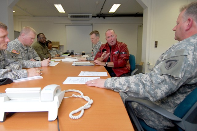 Members of the U.S. Army Europe/7th Army H1N1 Working Group, conduct a teleconference with other members throughout Europe at Campbell Barracks in Heidelberg, Germany. Hosted by the USAREUR/7th Army Office of the Command Surgeon, the weekly teleconference provides updates and collaborates with preventive medicine and garrison officials from across Europe, as well as with host nation and international surveillance organizations.