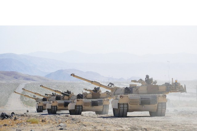 Four M1A1 Abrams tanks assigned to the 3HBCT, 3rd ID, line up on the firing line, before a qualifying range at Fort Irwin, Calif., July 7. Tank crews were required to qualify with their weapons systems before they began their two-week training rotation in the Mojave Desert.
