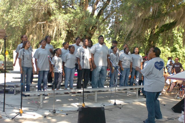 yMembers of the Project Reach GANG choir sing at the 11th Annual Project Reach GANG Back to School Rally, July 11.