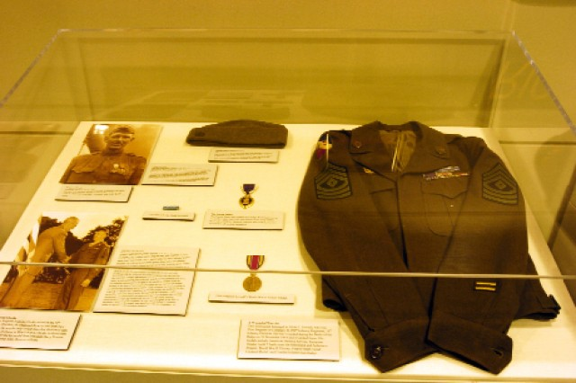 The valor of Army Reserve NCOs is shown in this case, which contains the field jacket of 1st Sgt. Alvin Loveall, who was wounded during the Battle of the Bulge on Dec. 31, 1944. Also pictured in the case are a photo of Sgt. Alvin York, the most-decorated American soldier of World War I (upper left) and Master Sgt. Nicholas Oresko, a World War II Medal of Honor recipient, receiving the medal from President Harry S. Truman (lower left).