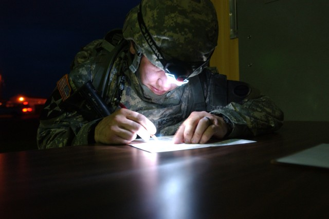 Sgt. Timothy S. McBride from Crown Point, Ind., who is assigned to the 85th Support Command, based in Arlington Heights, Ill., plots a known point on a map during night urban warfighting orientation course during the 2009 U.S. Army Reserve Command Best Warrior Competition held at Fort McCoy, Wis., July 12-18. The competition brought 28 Soldiers and non-commissioned officers from Guam to New Hampshire to Fort McCoy to determine the best of the Army Reserve. The Army Reserve winners will then compete in the Department of the Army competition held later this year at Fort Lee, Va.