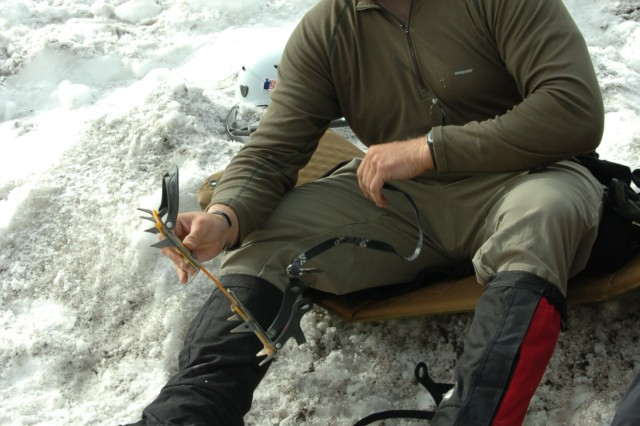 Sgt. 1st Class Jesse Yandell puts crampons on before receiving mountaineering training near Camp Muir on Mt. Rainier July 8, 2009.  Yandell, who is recovering from wounds sustained in Afghanistan, climbed to the summit of the volcano the next day.