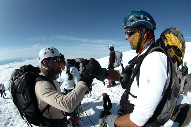 Sgt. 1st Class Mario Barragan (left) is congratulated by Art Rausch as he makes his way to the summit of Mt. Rainier July 9, 2009.