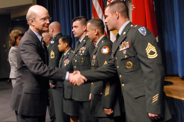 Secretary of the Army Pete Geren shakes hands with Sgt. 1st Class Brad A. Bond following the 2007 Secretary of the Army Career Counselor and Recruiter of the Year Awards March 26 at the Pentagon. Bond was named the 2007 Army National Guard Recruiting and Retention NCO of the Year.