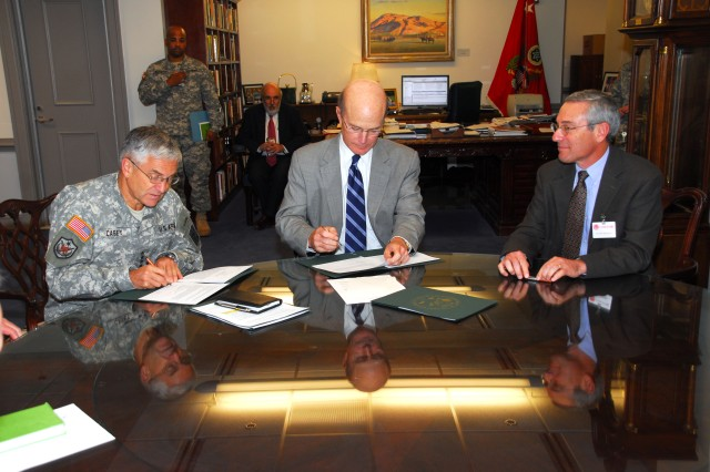 Chief of Staff of the Army Gen. George Casey, Secretary of the Army Pete Geren, and Thomas R. Insel, director, National Institute of Mental Health, sign a memorandum of agreement Oct. 23, 2008. Under the MOA, the NIMH agreed to conduct a research study for the Army that will focus on the mental and behavioral health of Soldiers, with particular focus on the multiple determinants of suicidal behavior.