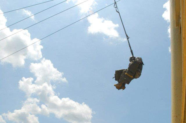 Swinging Away.jpg: A B Company Soldier swings away from the tower.