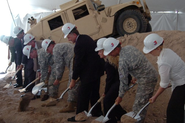 FORT BLISS, Texas - Sliver-plated shovels broke through the dirt, during a groundbreaking ceremony held July 17, where Freedom Crossing, the first of its kind marketplace inside a military installation, will exhibit local, regional, and national name-brand retail stores, dinning, and entertainment for Soldiers and families at Fort Bliss, Texas.