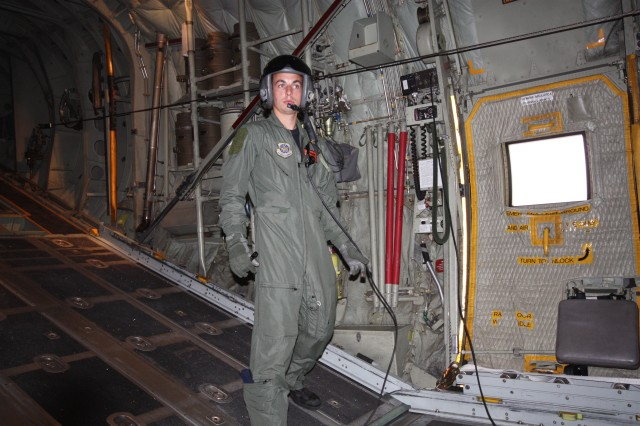 Senior Airman, Brad Emmett, Loadmaster, checks commo with the flight team aboard the C130H.