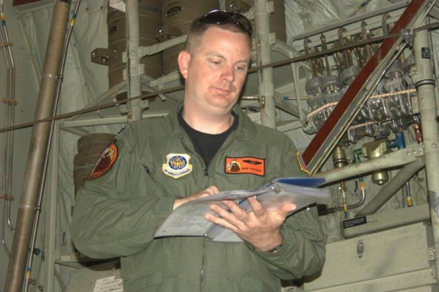 Aircraft Commander, Capt. Robert Dodson, goes through the pre-flight checklist on his C130H aircraft, in preparation for the paratrooper drop.