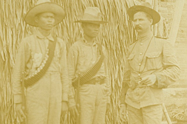 The Commander and his Scouts: This image shows Lt. Batson and two members of the Macabebe Scouts. (Spanish-American War Survey Photograph Collection).