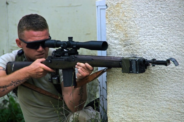 Sgt. Robert Murray, Delta Company, 1st Battalion, 4th Infantry Regiment, plays the bad guy during an training exercise at the Joint Multinational Readiness Center (JMRC) in Hohenfels, Germany.