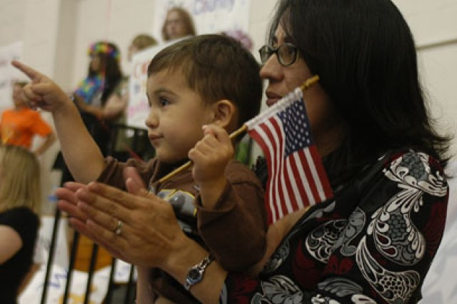 "This Fort Polk child points to daddy during what will be a ""get acquainted"" reunion."