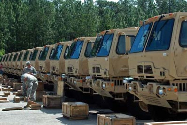 Soldiers from Forward Support Company E, 94th Brigade Support Battalion, 4th Brigade Combat Team, 10th Mountain Division lay out BII for FMTV trucks equipped with long-term armor strategy upgrades in the MCC yard on Fort Polk June 16. The 94th BSB is the first unit in the Army to receive LTAS FMTVs.