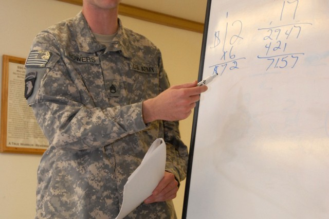 BAGHDAD - Staff Sgt. Kyle Bowers, the counter-improvised explosive device noncommissioned officer for the operations section of Company A, Division Special Troops Battalion, 1st Cavalry Division, shows the rest of the class how he got the answer to a math problem. Bowers, who hails from Fayetteville, N.C., was the class leader for this cycle. Bowers is attached to Co. A and his parent unit is the 18th Fires Brigade.