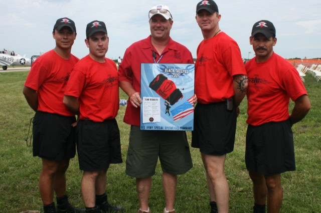 The Black Daggers present the Director of the Prairie Air Show, Brett Krause, with a team plaque after their last jump.