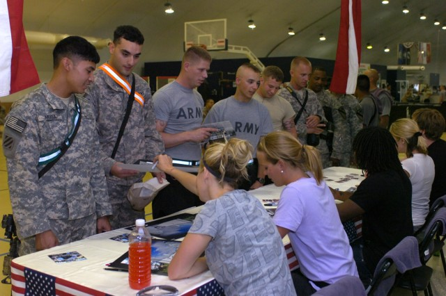 ESPN XGames athletes Sarah Burke, Grete Eliassen, Brad Simms, Jen O'Brien and Nate Holland came to visit the 3rd Heavy Brigade Combat Team, 1st Cavalry Division at Forward Operating Base Marez on July 19. They signed autographs and talked with the troops.
