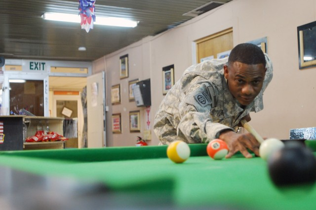 Sgt. Teo Garcia plays a game of pool at the Morale, Welfare and Recreation center July 20, on Joint Security Station Loyalty, located in the 9 Nissan district of eastern Baghdad. Garcia rejoined the Army in 2007 after losing a bet to his good friend and retired Army first sergeant Jeffery King.
