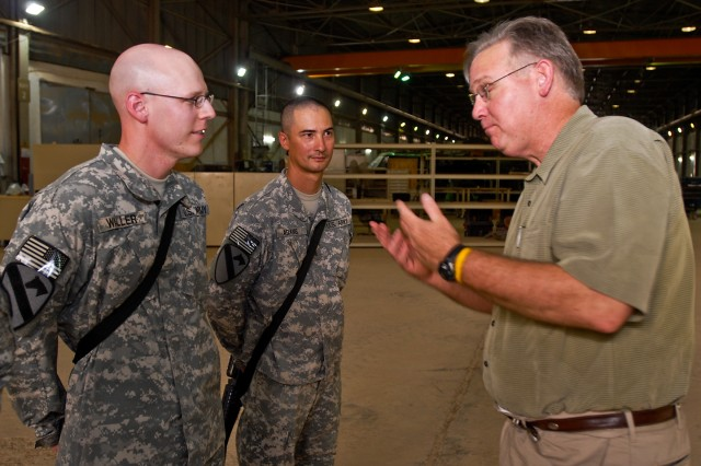 TAJI, Iraq- Missouri Gov. Jay Nixon (right), gestures enthusiastically as he discusses baseball with Sgt. Thomas Adams (center), from St Louis, Mo., transportation coordinator, Headquarters Support Company, 615th Aviation Support Battalion, 1st Air Cavalry Brigade, 1st Cavalry Division, Multi-National Division - Baghdad and Spc.Scott Waller, from Steelville, Mo., armament support, Co. B, 615th ASB, 1st ACB, July 18, at Camp Taji, Iraq. Nixon was part of a visit which also included governors from Illinois, Minnesota, Nevada and Texas.
